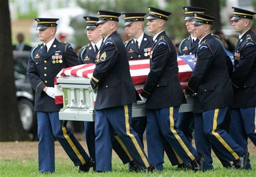 A casket with remains representing nine WW II Army Airmen is carried at a burial ceremony at Arlington National Cemetery in Arlington, Va., Wednesday, Sept. 21, 2011.