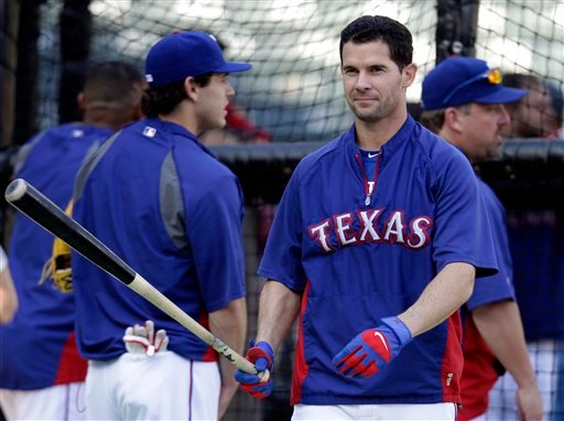Texas Rangers' Michael Young takes batting practice Friday, Oct. 21, 2011, in Arlington, Texas.
