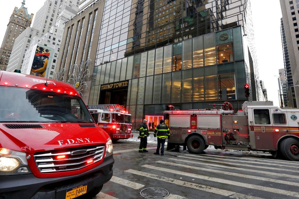New York City Fire Department vehicles sit on Fifth Avenue in front of Trump Tower, in New York, Monday, Jan. 8, 2018. The department said a fire started around 7 a.m. in the heating and air conditioning system of the building. (AP Photo/Richard Drew)