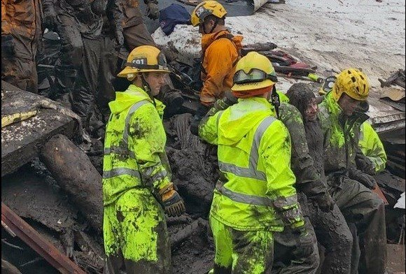 Santa Barbara County Fire Department, firefighters successfully rescue a 14-year-old girl, right, after she was trapped for hours inside a destroyed home in Montecito, Calif.