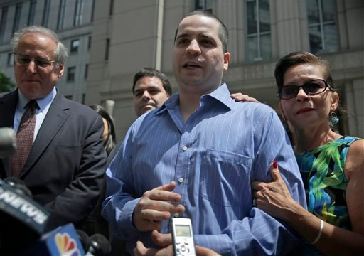 GIlberto Valle, center, makes a short statement to the assembled media as he leaves Manhattan federal court in New York, Tuesday, July 1, 2014.