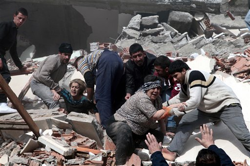 People rescue two women trapped under debris in Van eastsern Turkey after a powerful 7.2-magnitude earthquake struck eastern Turkey, collapsing about 45 buildings in Van province, Sunday, Oct. 23, 2011 according to the deputy Turkish prime minister. (AP)