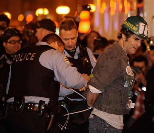 A protester gets arrested during an Occupy Chicago march and protest in Grant Park in Chicago, Sunday, Oct. 23, 2011. (AP)