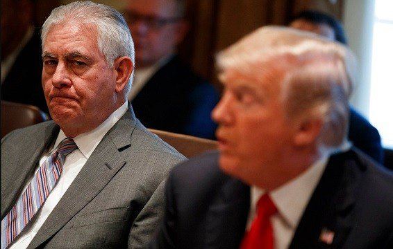 Secretary of State Rex Tillerson, left, listens to President Donald Trump speak during a cabinet meeting.