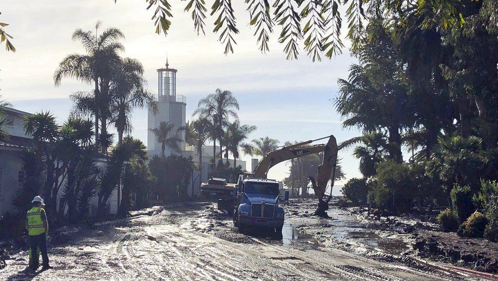 This photo shows the cleanup of mud and debris in front of the Coral Casino and Biltmore Hotel along Channel Drive in Montecito, Calif., Wednesday, Jan. 10, 2018. (Mike Eliason/Santa Barbara County Fire Department via AP)