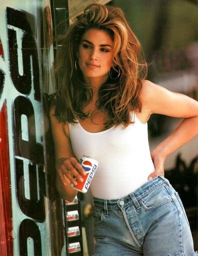 This image released by Pepsi shows actress-model Cindy Crawford in a scene from her 1992 iconic Super Bowl Pepsi commercial. Crawford returns for another Pepsi commercial which will premiere during Super Bowl LII on Feb. 4.