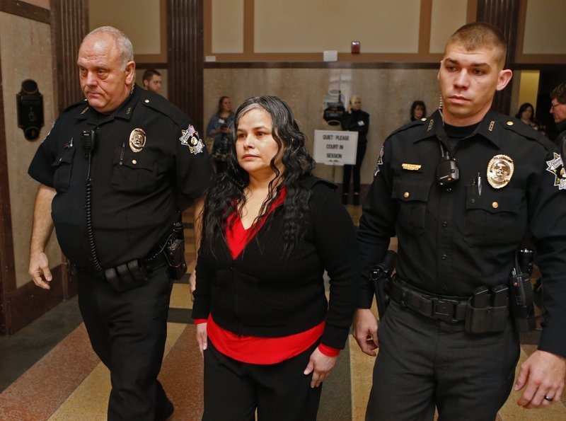 In this Jan. 9, 2018, file photo, Juanita Gomez is led into Oklahoma County District Court in Oklahoma City.