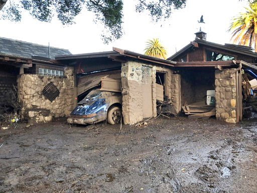 This photo provided by the Santa Barbara County Fire Department shows damage from mud, boulders, and debris that destroyed homes that lined Montecito Creek near East Valley Road in Montecito, Calif., Wednesday, Jan. 10, 2018.