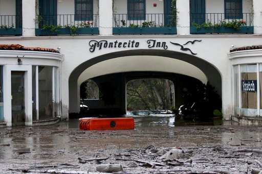 FILE - In this Tuesday, Jan. 9, 2018, file photo, debris and mud cover the entrance of the Montecito Inn after heavy rain brought flash flooding and mudslides to the area in Montecito, Calif.