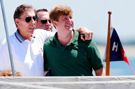 FILE - In this July 15, 2011 file photo, former U.S. Sen. John Tunney, left, stands with his arm around Patrick Kennedy on a pier in Hyannis Port, Mass., before Kennedy was to wed Amy Petitgout at the Kennedy Compound in Hyannis Port later in the day.