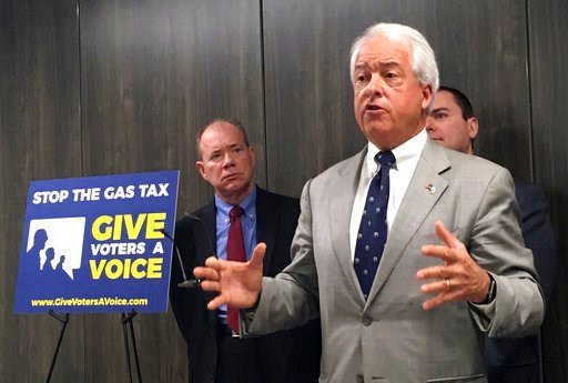 """FILE - In this Oct. 18, 2017 file photo, California Republican gubernatorial candidate John Cox, right, speaks in Sacramento, Calif., about his decision to spend """"significant"""" money on an effort to repeal California's newly passed gas and diesel tax incre"""