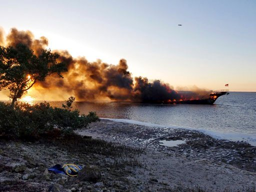 In this photo provided by Pasco County flames engulf a boat Sunday, Jan. 14, 2018, in the Tampa Bay area. Florida authorities say the casino venture's shuttle boat caught fire on Sunday and dozens of passengers safely made it to shore in Port Richie after