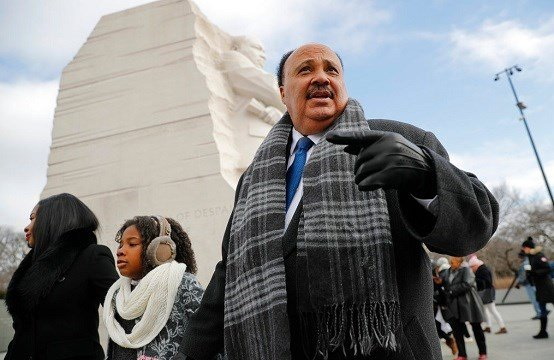 Martin Luther King III, right, with his wife Arndrea Waters, left, and their daughter Yolanda, 9, center, during their visit to the Martin Luther King Jr., Memorial.