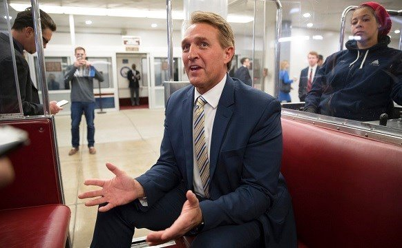 Sen. Jeff Flake, R-Ariz., talks to reporters just after a blistering speech on the Senate floor aimed at President Donald Trump.