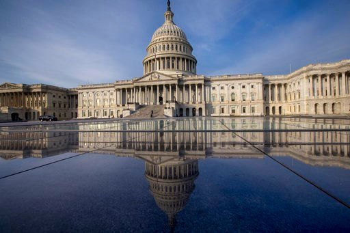 FILE- This Jan. 3, 2018, file photo shows the Capitol in Washington. The government is financed through Friday, Jan. 19, and another temporary spending bill is needed to prevent a partial government shutdown after that. (AP Photo/J. Scott Applewhite, File