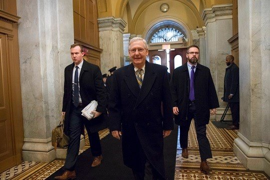 Senate Majority Leader Mitch McConnell, R-Ky., arrives at the Capitol in Washington.