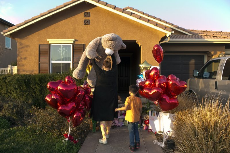 "Neighbor Liza Tozier, and her son, Avery Sanchez, 6, drop off his large ""Teddy"" as a gift for the children who lived on a home where police arrested a couple on Sunday accused of holding 13 children captive in Perris, Calif., Thursday, Jan. 18, 2018."