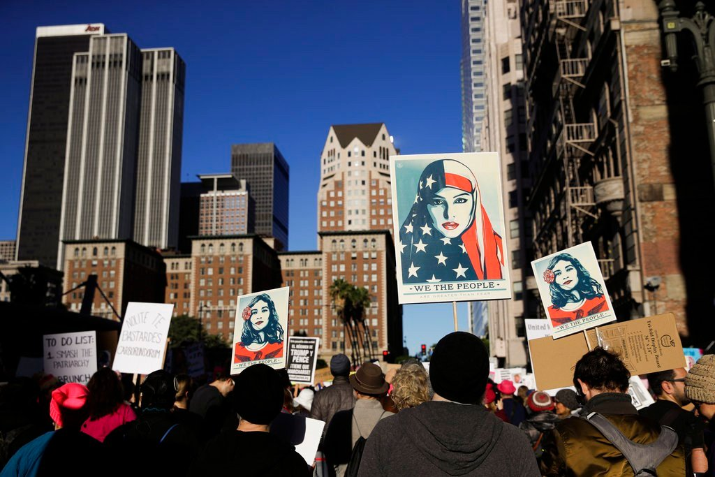 People gather for a Women's March, Saturday, Jan. 20, 2018, in Los Angeles. (AP Photo/Jae C. Hong)