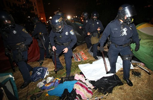 Oakland police search tents in Frank Ogawa Plaza as they disperse Occupy Oakland protesters on Tuesday, Oct. 25, 2011 in Oakland, Calif.