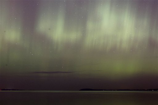 The northern lights shine over West Grand Traverse Bay near Traverse City, Mich., on Monday night, Oct. 24 2011.