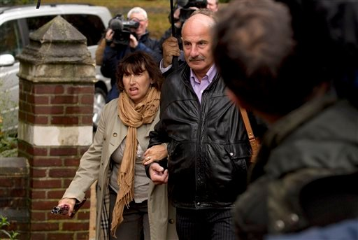 Amy Winehouse's mum Janis, left, arrives at St. Pancras Coroner's Court for a hearing into the singer's death in London Oct. 26, 2011. (AP Photo/Matt Dunham)