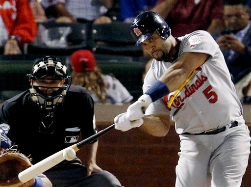 St. Louis Cardinals' Albert Pujols hits a solo home run during the ninth inning of Game 3 of baseball's World Series against the Texas Rangers, Saturday, Oct. 22, 2011, in Arlington, Texas. (AP Photo/Eric Gay)