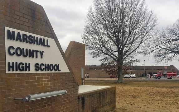 Authorities investigate the scene of fatal school shooting Tuesday, Jan 23, 2018, in Benton, Ky.