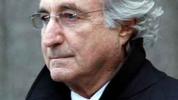 In this Wednesday, Jan. 14, 2009 file photo, Bernard L. Madoff, the accused mastermind of a $50 billion Ponzi scheme, leaves Federal Court in New York. (AP Photo/Stuart Ramson, file)