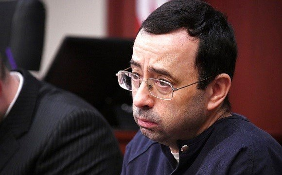 Larry Nassar looks at the gallery in the court during the sixth day of his sentencing hearing Tuesday, Jan. 23, 2018, in Lansing, Mich.