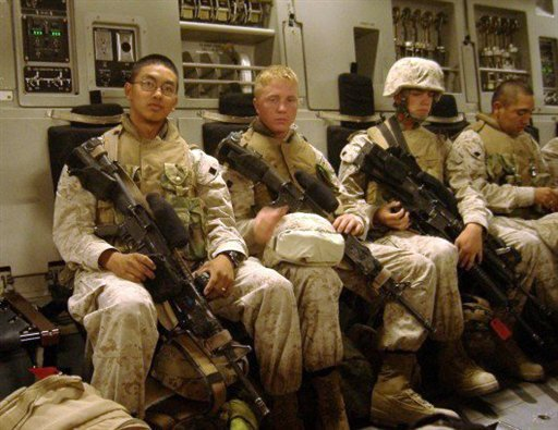 In this undated photo provided by Keith Shannon, Cong Nguyen, left, Keith Shannon, center, and Scott Olsen, right with helmet, are shown.