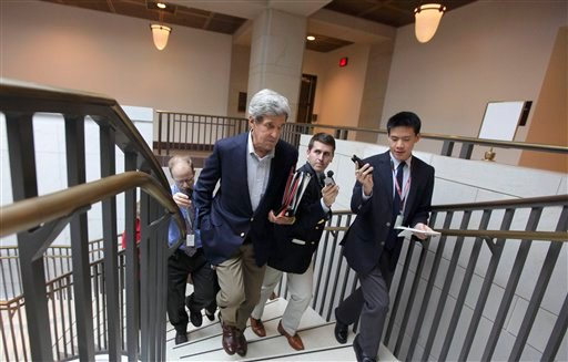 Supercommittee member Sen. John Kerry, D-Mass., is pursued by reporters as he leaves a closed-door meeting of the Joint Select Committee on Deficit Reduction on Capitol Hill in Washington, Tuesday, Sept. 27, 2011.