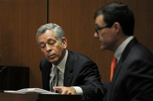 Defense attorney Ed Chernoff, right, approaches Dr. Robert Waldman an addiction specialist, during testimony in the final stage of Dr. Conrad Murray's defense case in Murray's involuntary manslaughter trial in Los Angeles on Thursday, Oct. 27, 2011.