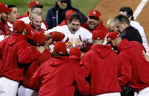 Teammates celebrate with St. Louis Cardinals' David Freese after Freese hit a walk-off home run during the 11th inning of Game 6 of baseball's World Series against the Texas Rangers Thursday, Oct. 27, 2011, in St. Louis. (AP)