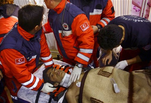 Turkish rescuers tend Ferhat Tokay, 13, after he was pulled from the rubble of a collapsed building in Ercis, Van, Turkey, early Friday, Oct. 28, 2011. (AP)