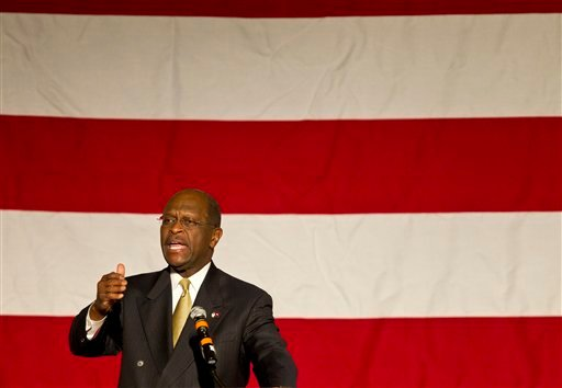 Presidental candidate Herman Cain speaks during the Washington County Republican Committee's annual Lincoln Day Dinner on Thursday, Oct. 27, 2011, in Springdale, Ark. (AP Photo/Beth Hall)