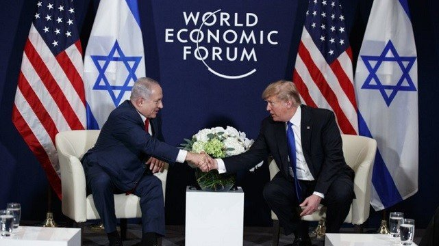 President Donald Trump shakes hands with Israeli Prime Minister Benjamin Netanyahu during a meeting at the World Economic Forum.