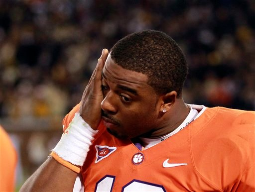 Clemson quarterback Tajh Boyd wipes his face as he paces on the sideline in the final moments of their 31-17 loss to Georgia Tech in an NCAA college football game in Atlanta, on Saturday, Oct. 29, 2011. (AP Photo/John Bazemore)