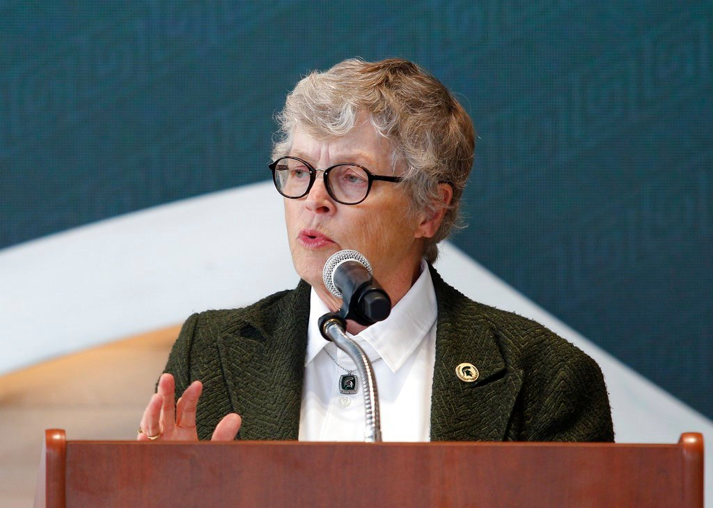 10/20/17 Michigan State University President Lou Anna Simon speaks during the dedication ceremony for the Gilbert Pavilion and Tom Izzo Hall of History inside Michigan State's Breslin Student Events Center. (AP Photo/Al Goldis, File)