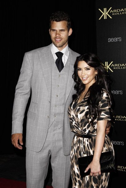 FILE - In this Aug. 17, 2011 file photo, reality TV personality Kim Kardashian, right, and her fiance, NBA basketball player Kris Humphries, arrive at the Kardashian Kollection launch party in Los Angeles.