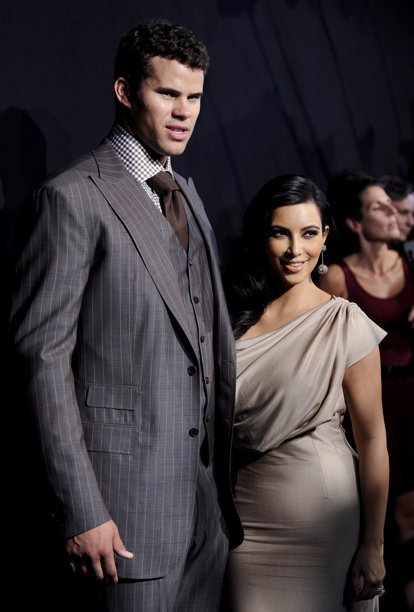 FILE - In this Aug. 31, 2011 file photo, newlyweds Kim Kardashian, right, and Kris Humphries attend a party thrown in their honor in New York. Kardashian is expected to file for divorce in Los Angeles on Monday, Oct. 31, 2011.