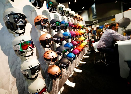 Ski helmets line a wall in the Smith booth at the Outdoor Retailer and Snow Show in the Colorado Convention Center Friday, Jan. 26, 2018, in Denver.
