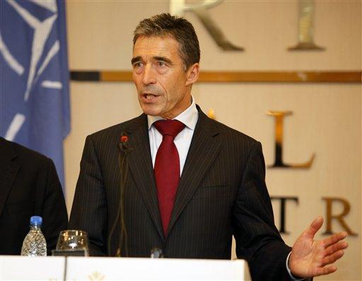 NATO Secretary-General Anders Fogh Rasmussen speaks to reporters in Tripoli, Libya, Monday, Oct. 31, 2011.