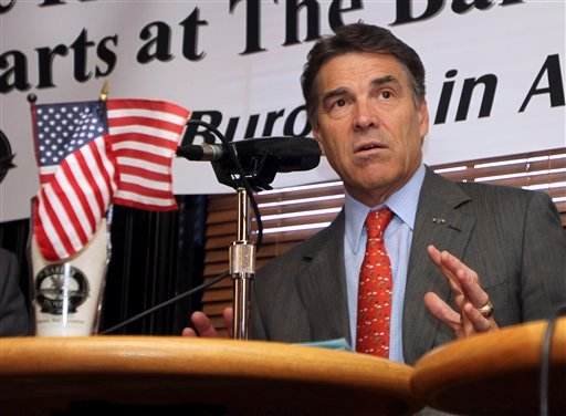 Republican presidential candidate, Texas Gov. Rick Perry tapes a radio show, Friday, Oct. 28, 2011, in Concord, N.H.