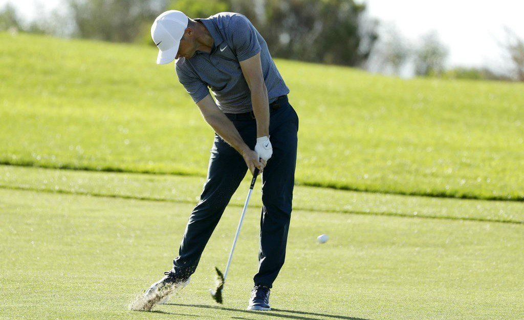 Alex Noren, of Sweden, hits his second shot on the 17th hole of the South Course at Torrey Pines Golf Course during the third round of the Farmers Insurance Open golf tournament, Saturday, Jan. 27, 2018, in San Diego. (AP Photo/Gregory Bull)