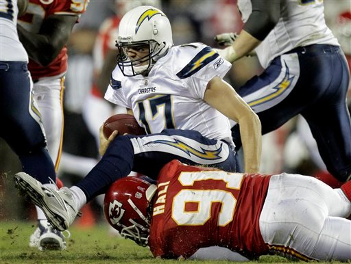 San Diego Chargers quarterback Philip Rivers, top, is sacked for a 7-yard loss by Kansas City Chiefs linebacker Tamba Hali during the fourth quarter of an NFL football game, Monday, Oct. 31, 2011, in Kansas City, Mo.
