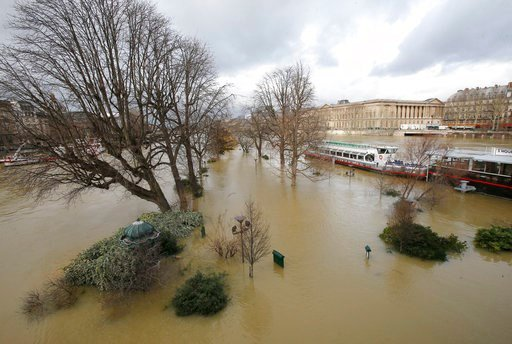 The banks of river Seine are flooded in Paris, France, Monday, Jan. 29, 2018. Floodwaters have reached a peak in Paris and are now threatening towns downstream along the rain-engorged Seine River. (AP Photo/Michel Euler)