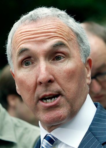 Los Angeles Dodgers owner Frank McCourt speaks to reporters outside court in this June 17, 2011 file photo taken in Los Angeles. (AP Photo/Nick Ut, File)