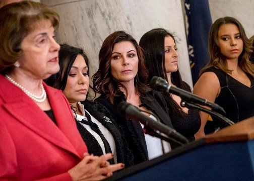 From left, Sen. Dianne Feinstein, D-Calif., accompanied by former U.S.A. gymnastics national team members and abuse survivors Jeanette Antolin, Jamie Dantzscher, Dominique Moceanu, and Mattie Larson.