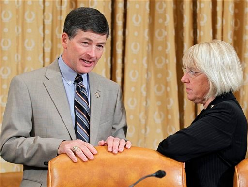 Rep. Jeb Hensarling, R-Texas, left, and Sen. Patty Murray, D-Wash., right, co-chairs of the Joint Select Committee on Deficit Reduction, confer at the start of a hearing on Capitol Hill in Washington, Tuesday, Nov. 1, 2011.