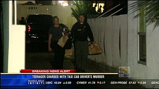 Investigators remove bags of evidence for the suspect's apartment in La Mesa